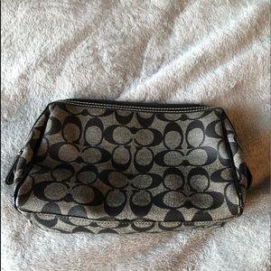 Black signature Coach makeup bag